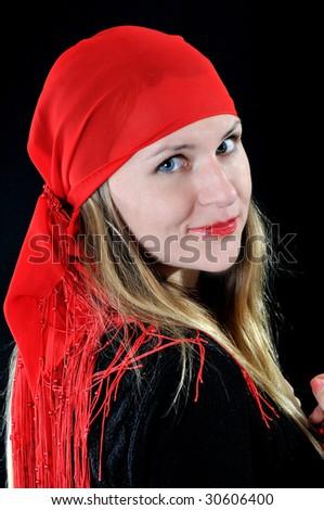 Nice girl in red bandana, on black background - stock photo