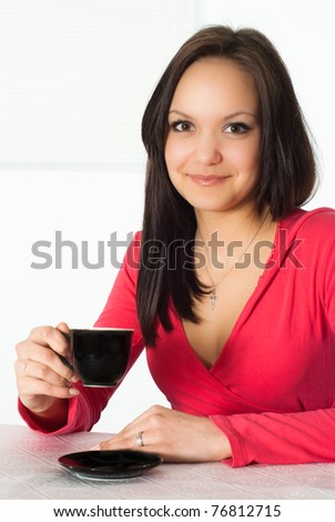 nice girl in the red with a cup