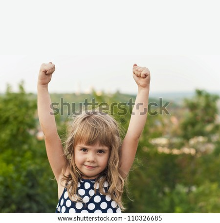 nice girl on the street with the lifted hands - stock photo