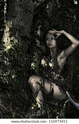 nice girl posing with a loincloth on the nature - stock photo