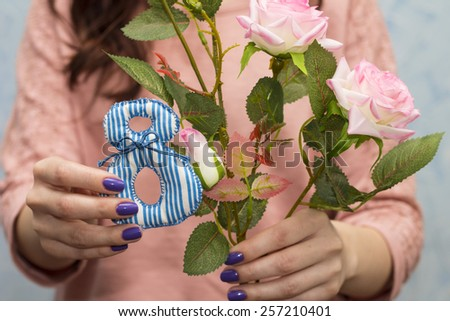 Nice girl posing with figure 8 and roses. International Women's Day concept - stock photo