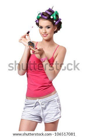 nice girl smiling and holding a lipstick - stock photo