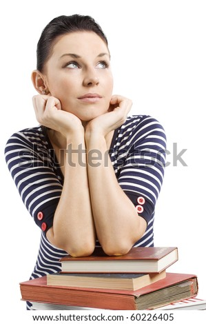 nice girl student in act to think with her arm over some books - stock photo