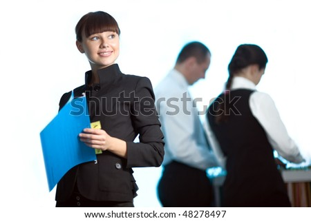 Nice girl with blue folder and men with women - stock photo