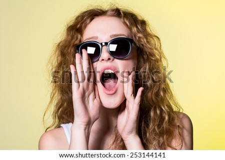 Nice girl with curly hair screaming. woman calls - stock photo