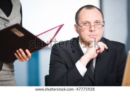 Nice girl with folder and men - stock photo