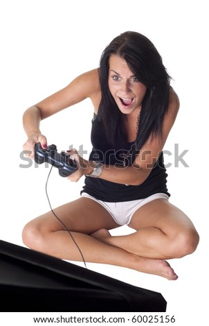 nice girl with gamepad playing - stock photo