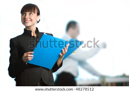 Nice girl with smile and with blue folder - stock photo