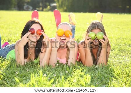 nice girls making fun outdoor - stock photo