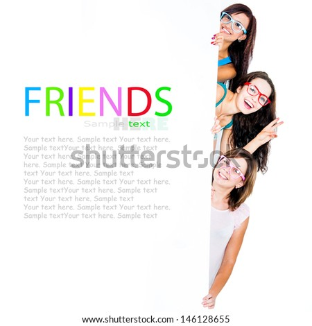 nice girls peeking from behind a blank banner with place for text - stock photo