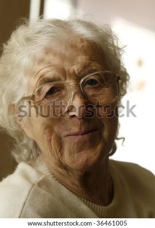 Nice grandmother smiling - stock photo