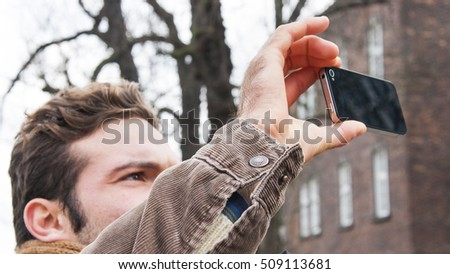 Nice guy who takes a picture with your smartphone