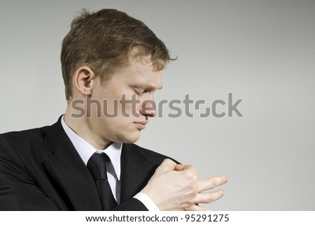 Nice guy will blow off the dust on the background - stock photo