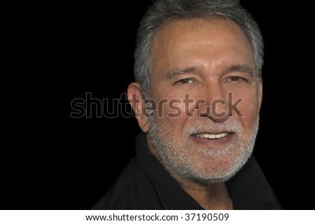 Nice Handsome Image of a latino man on black - stock photo