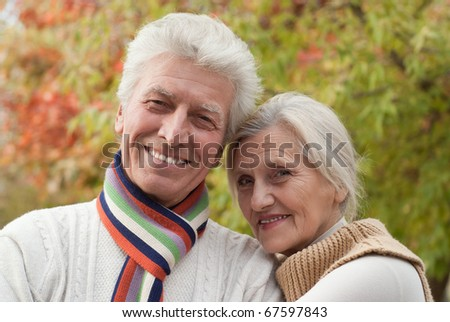 nice happy couple in a autumn park