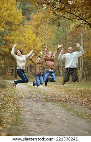 Nice happy family have a walk in the autumn park - stock photo