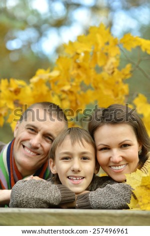 Nice happy family in the autumn park - stock photo