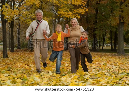 nice happy family of four in a park - stock photo