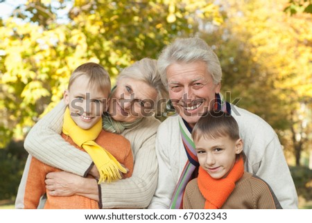 nice happy family of four on the nature