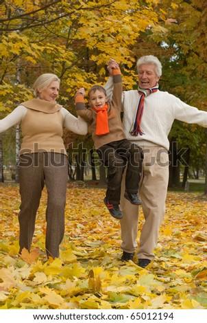 nice happy family of three in a park - stock photo