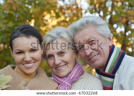nice happy family of three on the nature - stock photo