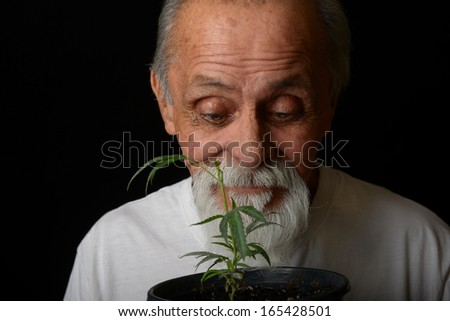 Nice Happy Image Of a Senior man who grows his own medicine - stock photo