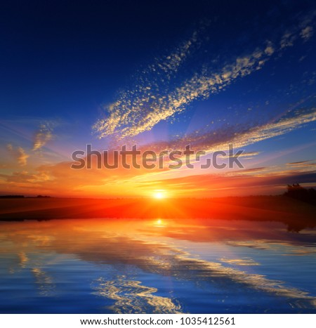 nice hot sunset over water surface