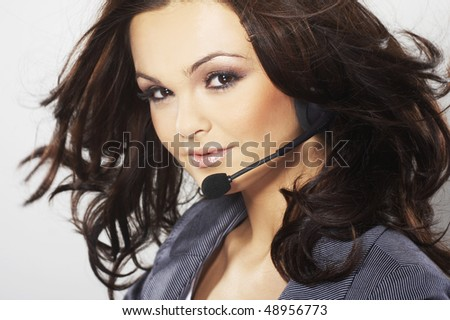 Nice hotline operator with headset - stock photo