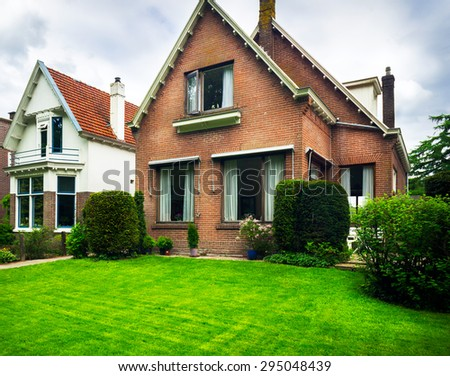 Nice house and yard in the suburbs. - stock photo
