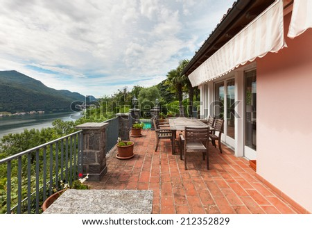 Nice house, outdoor, lake view from the balcony - stock photo
