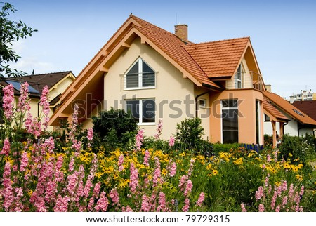 NICE HOUSE WITH THE FLOWERS - stock photo