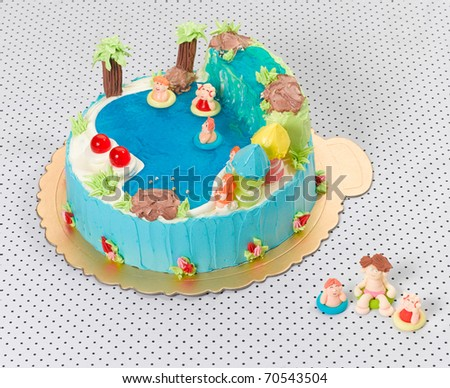 Nice idea to make fancy cake with waterfall icing cartoon and pool - stock photo