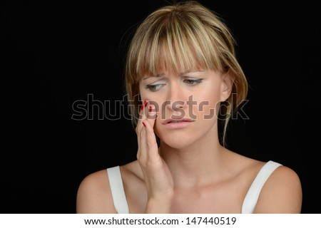 Nice image of a Beautiful Woman with toothache - stock photo