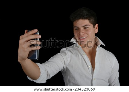 Nice Isolated Image of a Young Latino Doing a Selfie - stock photo
