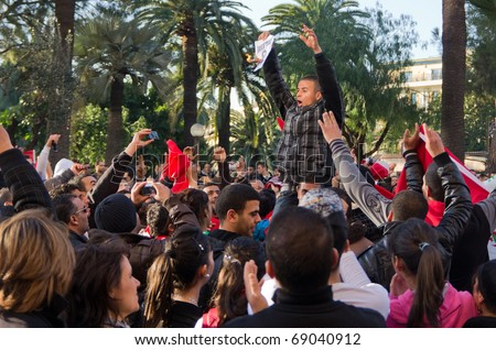NICE - 15 JANUARY: tunisian manifestants rally the street of the city after the runaway of dictator Ben Ali from Tunisia yesterday evening,15 january 2010  in Nice France