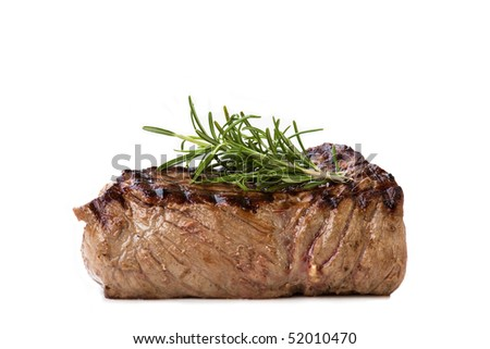 Nice juicy flame grilled Filet Mignon isolated on white - stock photo