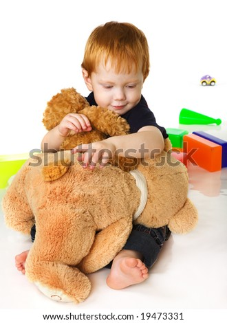 Nice kid with toy bears