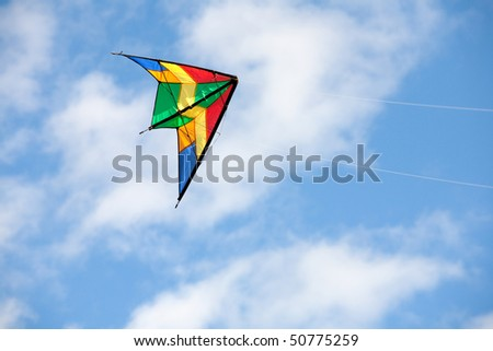 Nice kite flying colors against the blue sky - stock photo