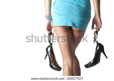 nice lady holding her heels - stock photo