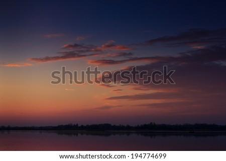 Nice landscape with sunset on lake  - stock photo