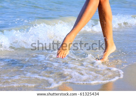 nice legs of a pretty girl walking in water