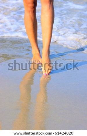 nice legs of a pretty girl walking in water - stock photo
