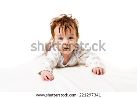 Nice little baby with disheveled hair crawling isolated on white background