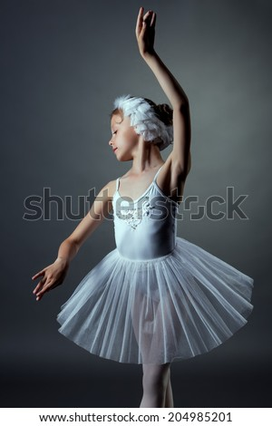 Nice little girl dancing role of White Swan - stock photo