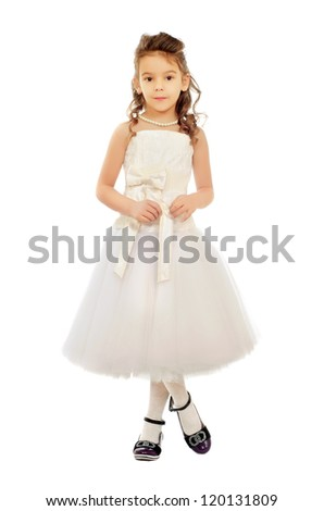 Nice little girl in a white dress