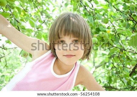 Nice little girl on the apple tree.