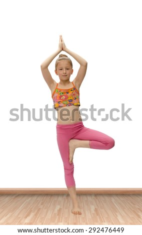 nice little girl practices yoga - stock photo