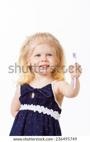 Nice little girl with toothbrush in her hand on white background - stock photo