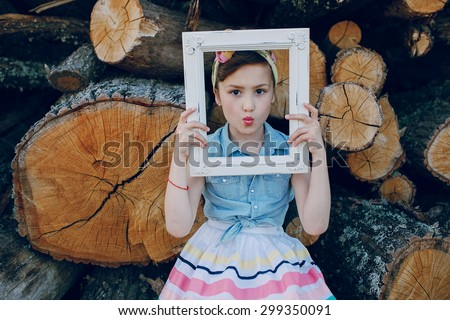 nice little model posing on a background of wooden beams - stock photo