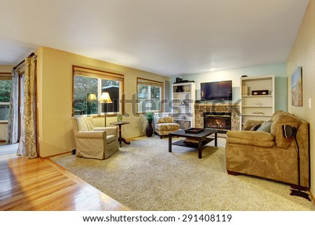 Nice living room with fireplace and decor. - stock photo